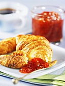Croissant with orange-strawberry marmelade