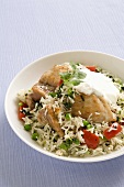 Pilau rice with chicken, spinach, peas and pepper