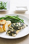Salmon fillets with a herb crust with potatoes and green beans