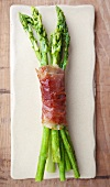 Roasted green asparagus wrapped in parma ham