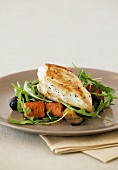 Barbecued chicken breast on sweet potatoes and rocket