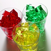 Cubes of red, yellow and green jelly in glasses