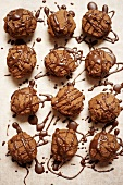 Filled chocolate cookies with chocolate piping
