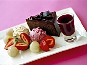 Piece of chocolate cake, 2 scoops of ice cream, berries & syrup