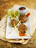 Three meatballs with lemon grass and dip