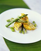 Curried cod with green asparagus