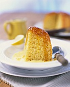 A piece of lemon cake with syrup in custard