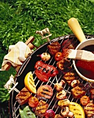 Barbecued meat and vegetables on a barbecue