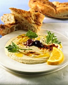 Hummus (chick-pea dip) on plate with flatbread