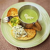 Pea soup in a cup with two bruschetta