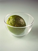 A lime in a small glass bowl