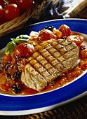 Barbecued tuna on tomato and olive sauce