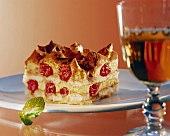 Layered dessert with sponge and raspberries, tiramisu style