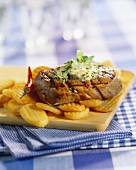 Barbecued beef steak with fried potato slices