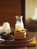 Still life with chocolate, dairy products and biscuits