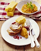 Turkey with mashed sweet potatoes, cranberries & corn bread