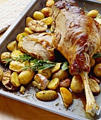 Leg of lamb with roast potatoes and rosemary