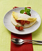 Soufflé omelette, folded over, with strawberries