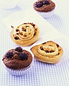 Chocolate & blackberry muffins & coiled marzipan & raisin buns