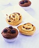 Chocolate & blackberry muffins & coiled marzipan & raisin buns