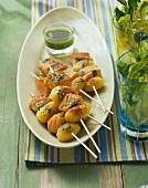 Potato and salmon kebabs with rocket pesto