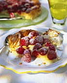 Piece of puff pastry flan with vanilla blancmange & raspberries