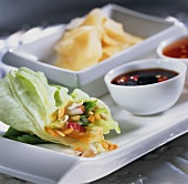 Lettuce rolls with various sauces and preserved ginger