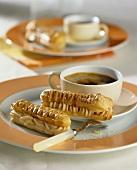 Coffee with two mocha éclairs