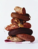 Several black puddings in a pile