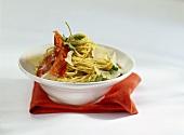 Spaghetti with pumpkin seed pesto and prosciutto