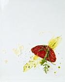 Carpaccio con la rucola (Marinated, raw beef sirloin)