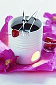 Chocolate fondue with cherries