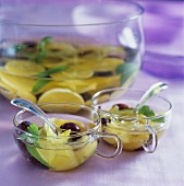 Exotic punch with carambola, lemons and grapes