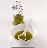 Olive oil in a bottle and a small bowl