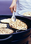 Indian flatbread being grilled