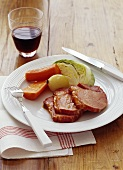 Smoked pork loin with vegetables and wine