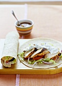Wrap with spicy chicken, salad and minted yoghurt