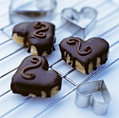 Three chocolate biscuits in shape of heart