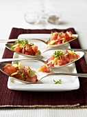 Diced salmon and vegetables in four spoons