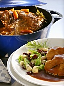 Braised leg of lamb with beans