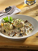 Creamed mushrooms with bacon dumpling