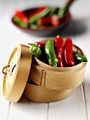 Chili peppers in a steaming basket