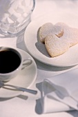 Heart-shaped biscuits with a cup of coffee