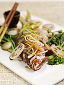 Steamed fish with sliced lotus root and vegetables