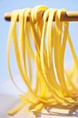 Home-made ribbon pasta hanging up