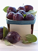 Plums in a wooden basket