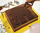 Chocolate cake with elephant motif for child's birthday
