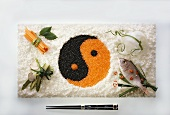 Yin-yang symbol made from caviare in rice