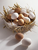Eggs on straw in wire basket