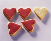 Five heart-shaped biscuits with mango icing